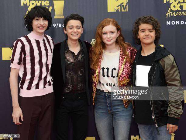 Actors Finn Wolfhard Noah Schnapp Sadie Sink and Gaten Matarazzo attend the 2018 MTV Movie TV awards at the Barker Hangar in Santa Monica on June 16...
