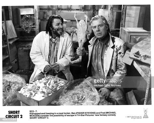 Actors Fisher Stevens and Michael McKean on set of the movie Short Circuit 2 circa 1988