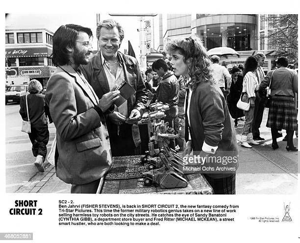 Actors Fisher Stevens Michael McKean and actress Cynthia Gibb on set of the movie Short Circuit 2 circa 1988