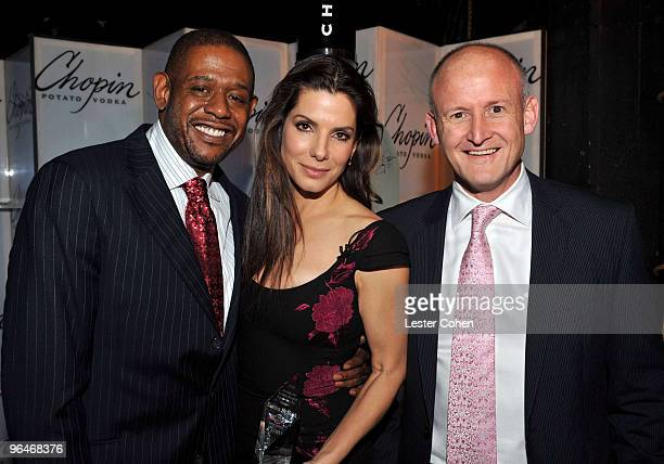 Actors Forest Whitaker and Sandra Bullock and Chopin's Charles Gibb arrive at the American Riveria Award event presented by Chopin Vodka at the 25th...