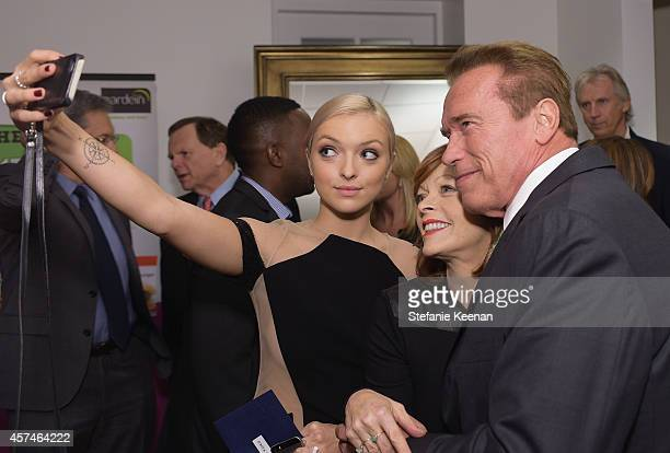 Actors Francesca Eastwood Frances Fisher and honoree Arnold Schwarzenegger attend the 24th Annual Environmental Media Awards presented by Toyota and...