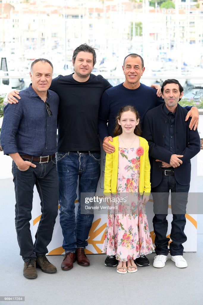 Actors Francesco Acquaroli, Edoardo Pesce, director Matteo Garrone, actors Marcello Fonte and Alida Baldari Calabria attend the photocall for the 'Dogman' during the 71st annual Cannes Film Festival at Palais des Festivals on May 17, 2018 in Cannes, France.