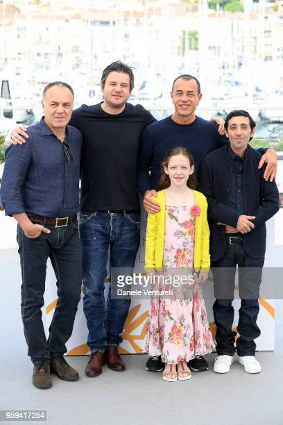 Actors Francesco Acquaroli Edoardo Pesce director Matteo Garrone actors Marcello Fonte and Alida Baldari Calabria attend the photocall for the...
