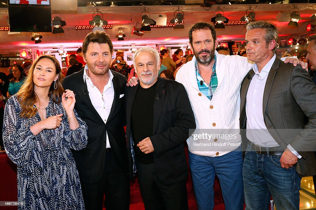 Actors Francis Perrin (C) who present the TV serie 'Mongeville', Vanessa Demouy (L) and her husband Philippe Lellouche (2nd L), Christian Vadim (2nd R) and David Brecourt (R) present the theater play 'L'appel de Londres' and celebrate their 10 years of playing together in 4 plays attend the 'Vivement Dimanche' French TV Show, held at Pavillon Gabriel on May 14, 2014 in Paris, France.