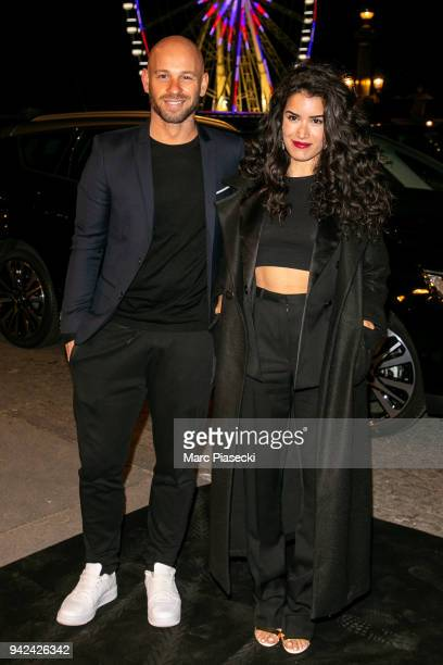 Actors Franck Gastambide and Sabrina Ouazani arrive to attend the 'Madame Figaro' dinner at Automobile Club de France on April 5 2018 in Paris France