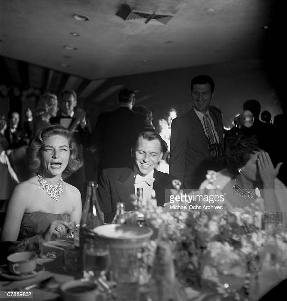 Actors Frank Sinatra and Lauren Bacall attend a party after the Academy Awards on March 30 1955 in Los Angeles California