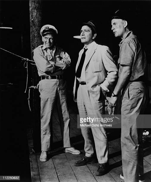 Actors Frank Sinatra Richard Conte and Alf Kjellin in a scene from the movie 'Assault On A Queen' in 1966