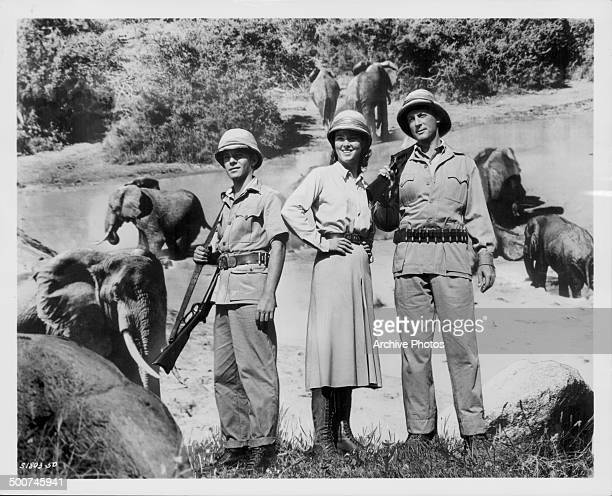 Actors Frankie Avalon Mariette Hartley and Lloyd Bochner on the set of the movie 'Drums of Africa' 1963