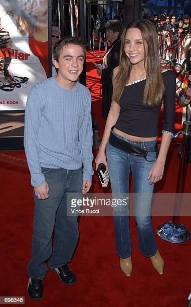 Actors Frankie Muniz and Amanda Bynes attend the premiere of the film Big Fat Liar February 2 2002 at Universal Studios in Los Angeles CA