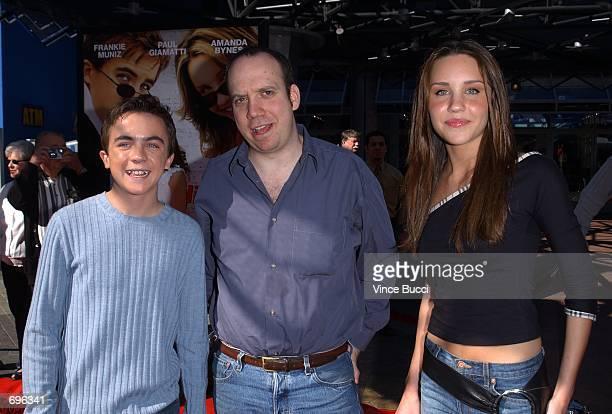 Actors Frankie Muniz Paul Giamatti and Amanda Bynes attend the premiere of the film Big Fat Liar February 2 2002 at Universal Studios in Los Angeles...