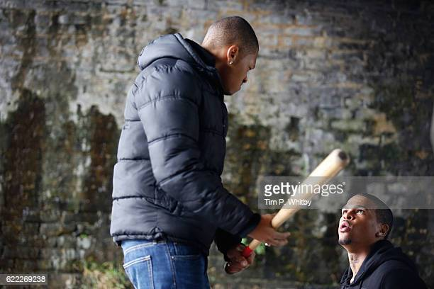 Actors Franz Drameh and Kola Bokinni on the set of 100 Streets in Battersea on September 1 2014 in London England