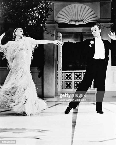 Actors Fred Astaire as Jerry Travers and Ginger Rogers as Dale Tremont in the film 'Top Hat' 1935