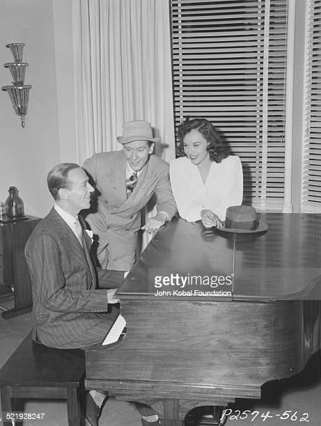 Actors Fred Astaire Burgess Meredith and Paulette Goddard for Paramount Pictures on the set of the movie 'Second Chorus' 1940