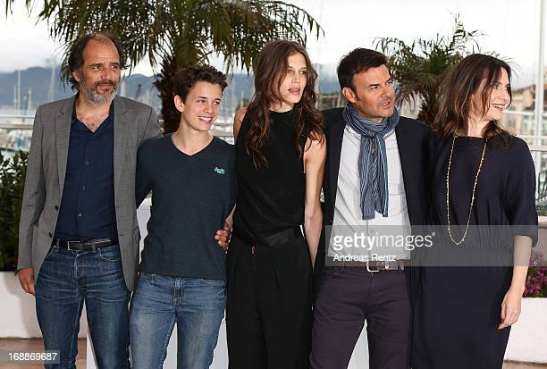 Actors Frederic Pierrot Fantin Ravat actress Geraldine Pailhas Director Francois Ozon and Marine Vacth attend the 'Jeune Jolie' Photocall during the...