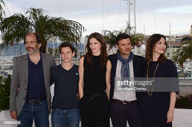 Actors Frederic Pierrot Fantin Ravat Marine Vacth director Francois Ozon and actress Geraldine Pailhas attend the photocall for 'Jeune Jolie' during...
