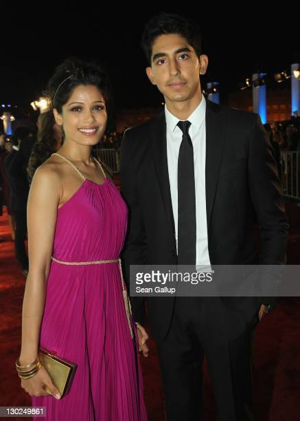 "Actors Freida Pinto and Dev Patel arrive at ""Black Gold"" world premiere during Doha Tribeca Film Festival Opening Night at Katara Open Air Theatre..."