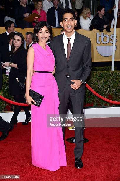Actors Freida Pinto and Dev Patel arrive at the 19th Annual Screen Actors Guild Awards held at The Shrine Auditorium on January 27 2013 in Los...