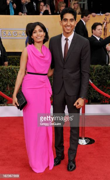 Actors Freida Pinto and Dev Patel arrive at the 19th Annual Screen Actors Guild Awards at The Shrine Auditorium on January 27 2013 in Los Angeles...