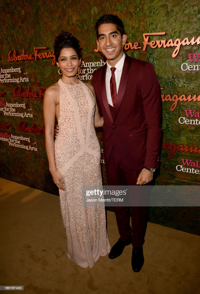 Actors Freida Pinto (L) and Dev Patel, wearing Ferragamo, arrive at the Wallis Annenberg Center for the Performing Arts Inaugural Gala presented by Salvatore Ferragamo at the Wallis Annenberg Center for the Performing Arts on October 17, 2013 in Beverly Hills, California.