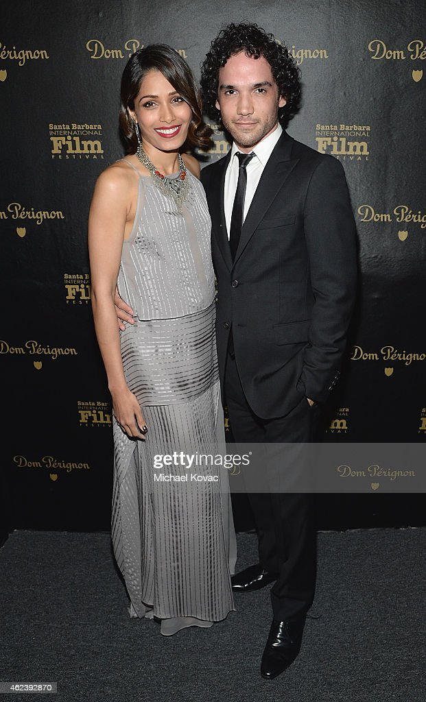 Actors Freida Pinto (L) and Reece Ritchie visit the Dom Perignon Lounge at The Santa Barbara International Film Festival to celebrate the opening night film 'Desert Dancer' on January 27, 2015 in Santa Barbara, California.