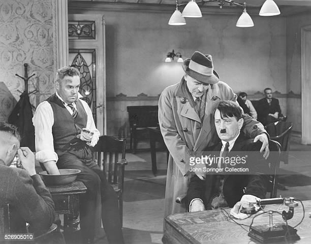 Actors Fritz Kortner Luis Van Rooten and Bobby Watson together in a scene from 1944 film The Hitler Gang Kortner played the role of Gregor Strasser...