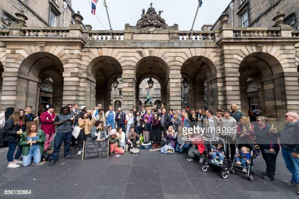 Actors from Fringe company 2theatre are joined by tourists for a massive syncronised banana eating in front of City Chambers to promote their show...