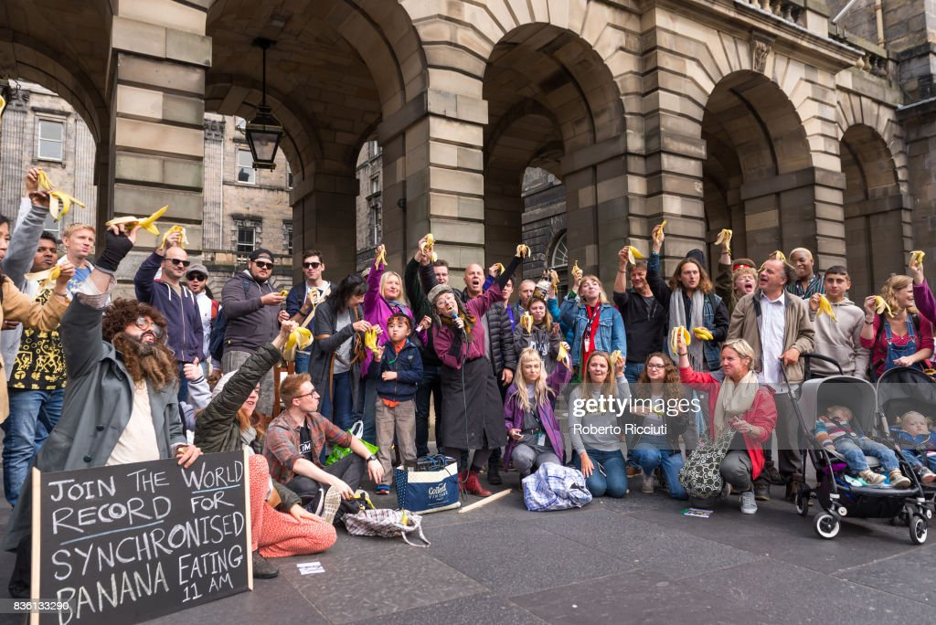 Actors from Fringe company 2theatre are joined by tourists for a massive syncronised banana eating in front of City Chambers to promote their show 'Losing It!' on the Royal Mile during the 70th Edinburgh Fringe Festival on August 21, 2017 in Edinburgh, Scotland.