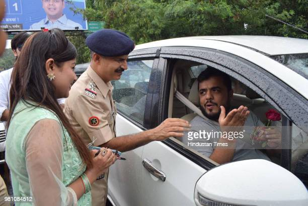 Actors from Marathi movie Dry Day present greetings and flowers to motorists who flouted rules and those following rules were bestowed with...