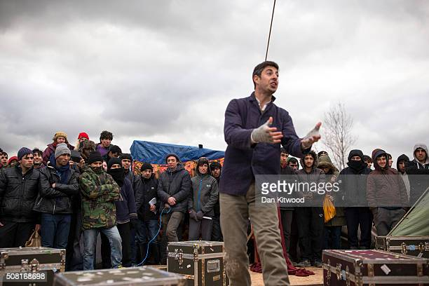 Actors from Shakespeare's Globe perform Hamlet to migrants at the Good Chance Theatre Tent in the Jungle Refugee Camp on February 3 2016 in Calais...