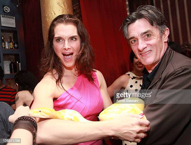 Actors from the Broadway cast of The Addams Family Brooke Shields and Roger Rees attend a private burlesque performance at Nurse Bettie on September...