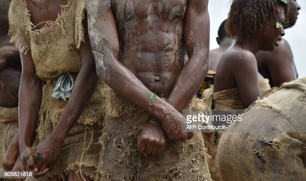 Actors from the National Center of Arts and Culture perform during the inauguration ceremony of a memorial stone at a site of the former slave route...