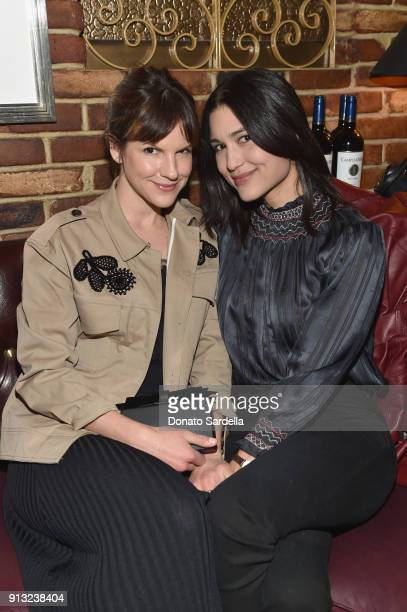 Actors Fuchsia Sumner and Julia Jones attend Edie Parker's LA Dinner Party at La Dolce Vita on February 1 2018 in Beverly Hills California