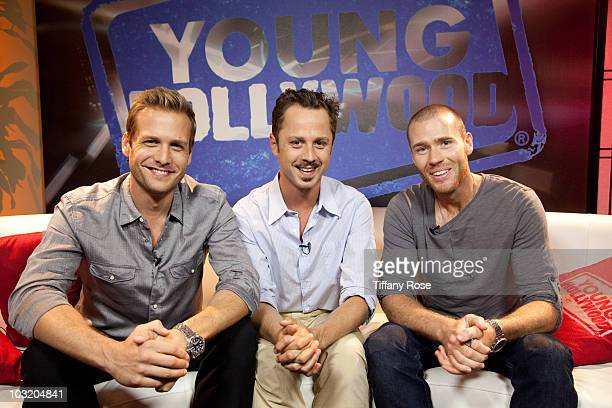 LOS ANGELES CA AUGUST 01 Actors Gabriel Macht and Goivanni Ribisi pose with host Oliver Trevena at Young Hollywood Studios on August 1 2010 in Los...