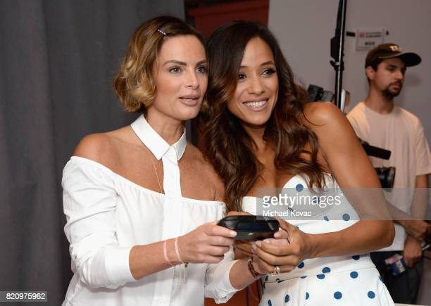 Actors Gabrielle Anwar and Dania Ramirez from the television series 'Once Upon A Time' stopped by Nintendo at the TV Insider Lounge to check out...