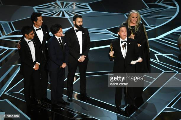 Actors Gael Garcia Bernal Benjamin Bratt and Anthony Gonzalez codirectors Adrian Molina and Lee Unkrich and producer Darla K Anderson accept Best...