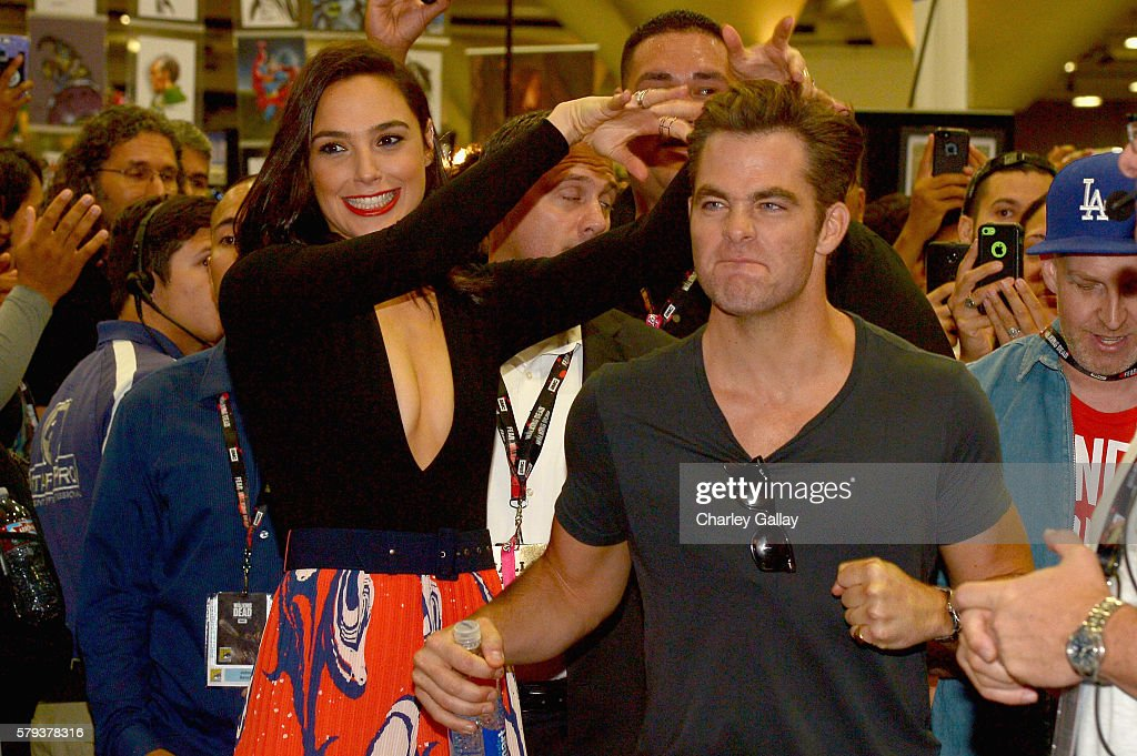 Actors Gal Gadot (L) and Chris Pine from the 2017 feature film Wonder Woman attend an autograph signing session for fans in DC's 2016 San Diego Comic-Con booth at San Diego Convention Center on July 23, 2016 in San Diego, California.