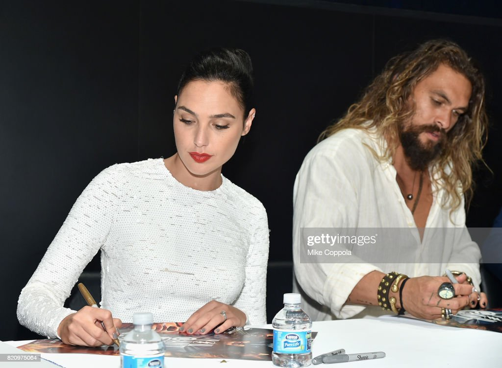 Actors Gal Gadot (L) and Jason Momoa during the 'Justice League' autograph signing at Comic-Con International 2017 at San Diego Convention Center on July 22, 2017 in San Diego, California.