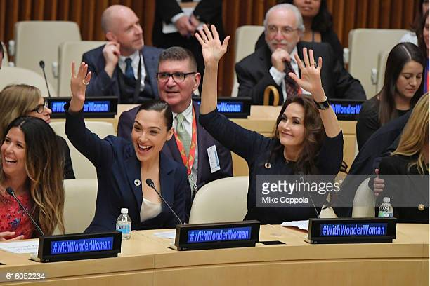 Actors Gal Gadot and Lynda Carter wave to the audience at the Wonder Woman UN Ambassador Ceremony at United Nations on October 21 2016 in New York...