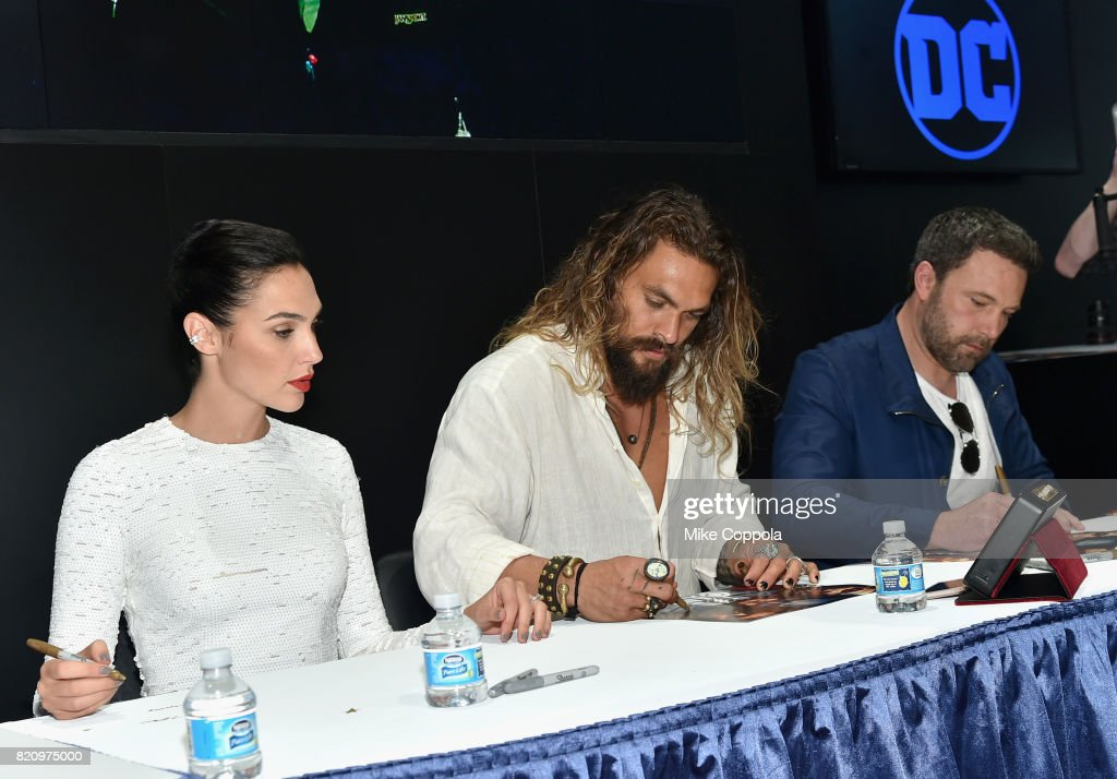 Actors Gal Gadot, Jason Momoa and Ben Affleck during the 'Justice League' autograph signing at Comic-Con International 2017 at San Diego Convention Center on July 22, 2017 in San Diego, California.