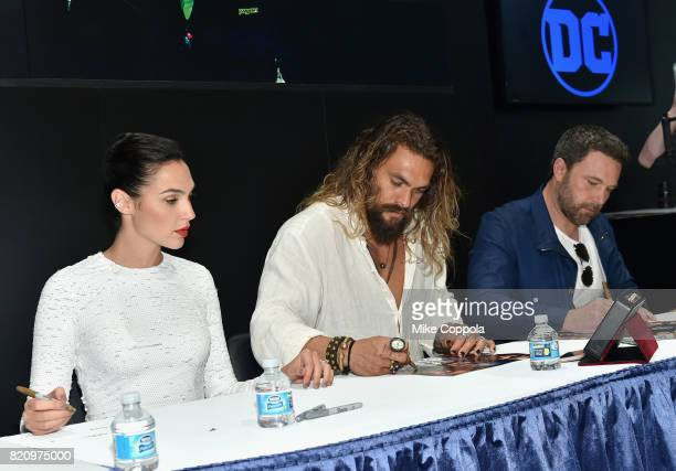Actors Gal Gadot Jason Momoa and Ben Affleck during the Justice League autograph signing at ComicCon International 2017 at San Diego Convention...