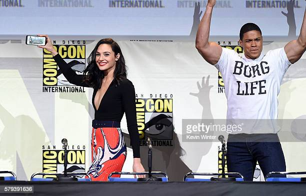 Actors Gal Gadot taking a selfie and Ray Fisher attend the Warner Bros 'Justice League' Presentation during ComicCon International 2016 at San Diego...