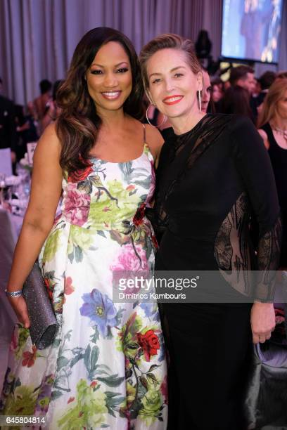 Actors Garcelle Beauvais and Sharon Stone attend the 25th Annual Elton John AIDS Foundation's Academy Awards Viewing Party at The City of West...