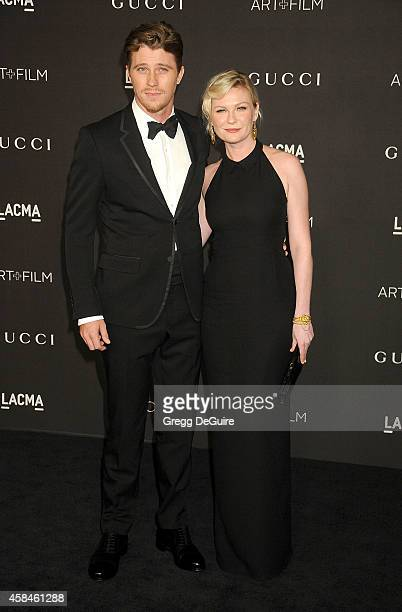 Actors Garrett Hedlund and Kirsten Dunst attend the 2014 LACMA Art Film Gala Honoring Barbara Kruger And Quentin Tarantino Presented By Gucci at...