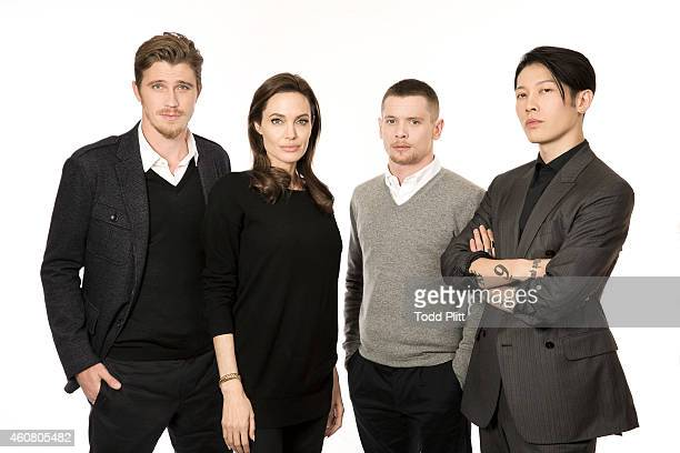 Actors Garrett Hedlund Jack O'Connell Miyavi Ishihara and director Angelina Jolie are photographed for USA Today on December 5 2014 in New York City