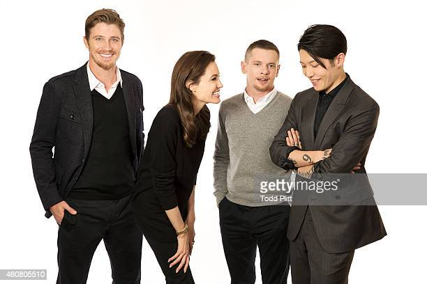 Actors Garrett Hedlund Jack O'Connell Miyavi Ishihara and director Angelina Jolie are photographed for USA Today on December 5 2014 in New York City...