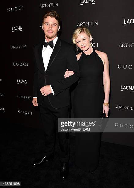 Actors Garrett Hedlund wearing Gucci and Kirsten Dunst wearing Gucci attend the 2014 LACMA Art Film Gala honoring Barbara Kruger and Quentin...