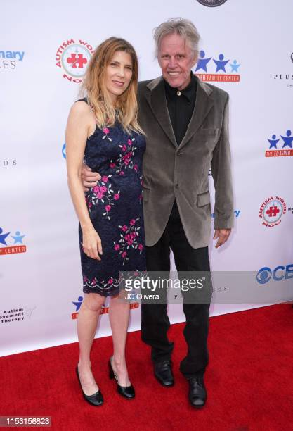 Actors Gary Busey and Steffanie Sampson attend the 7th Annual Ed Asner And Friends Poker Tournament Celebrity Night at CBS Studios Radford on June 01...