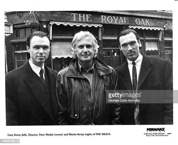 Actors Gary Kemp director Peter Medak and Martin Kemp pose on set of the Miramax movie The Krays circa 1990