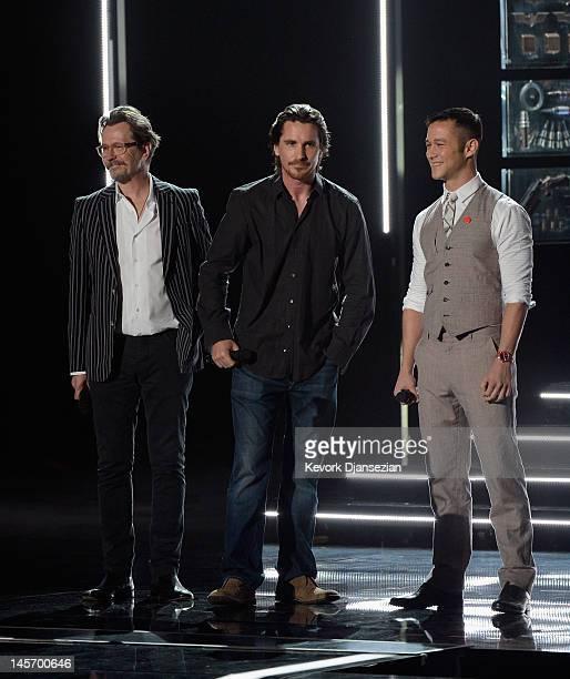 Actors Gary Oldman Christian Bale and Joseph GordonLevitt speak onstage during the 2012 MTV Movie Awards at Gibson Amphitheatre on June 3 2012 in...