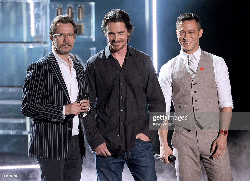 Actors Gary Oldman, Christian Bale, and Joseph Gordon-Levitt speak onstage during the 2012 MTV Movie Awards held at Gibson Amphitheatre on June 3, 2012 in Universal City, California.